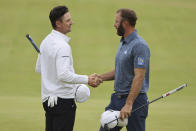 England's Justin Rose, left shakes hands with United States' Justin Rose after they completed their first round in the British Open Golf Championship at Royal St George's golf course Sandwich, England, Thursday, July 15, 2021. (AP Photo/Ian Walton)
