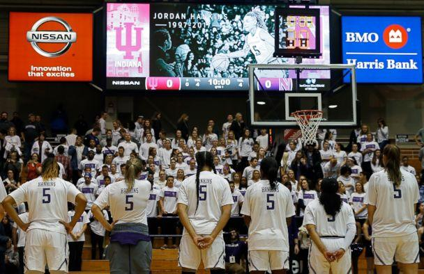 PHOTO: Northwestern University womens' basketball players, all wearing the jersey number of teammate Jordan Hankins, bow their heads during a moment of silence at the Welsh Ryan Arena in Evanston, Ill., Jan. 14, 2017. (Jim Young/Chicago Tribune/TNS via Newscom, FILE)