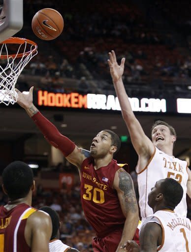 Iowa State's Royce White (30) shoots past Texas defenders Clint Chapman (53) and Sheldon McClellan (1) during the first half of an NCAA college basketball game, Tuesday, Jan. 24, 2012, in Austin, Texas. (AP Photo/Eric Gay)