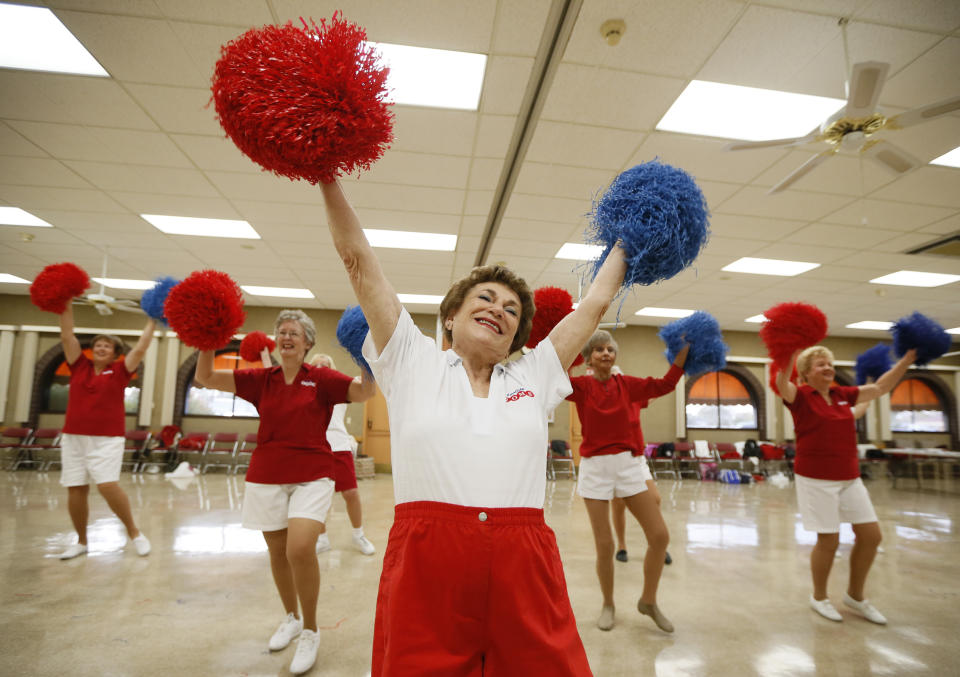 Pat Weber, 81, leads the Sun City Poms cheerleader dancers as they rehearse in Sun City, Arizona, January 7, 2013. Sun City was built in 1959 by entrepreneur Del Webb as America?s first active retirement community for the over-55's. Del Webb predicted that retirees would flock to a community where they were given more than just a house with a rocking chair in which to sit and wait to die. Today?s residents keep their minds and bodies active by socializing at over 120 clubs with activities such as square dancing, ceramics, roller skating, computers, cheerleading, racquetball and yoga. There are 38,500 residents in the community with an average age 72.4 years. Picture taken January 7, 2013.  REUTERS/Lucy Nicholson (UNITED STATES - Tags: SOCIETY TPX IMAGES OF THE DAY)    ATTENTION EDITORS - PICTURE 20 OF 30 FOR PACKAGE 'THE SPORTY SENIORS OF SUN CITY'  SEARCH 'SUN CITY' FOR ALL IMAGES