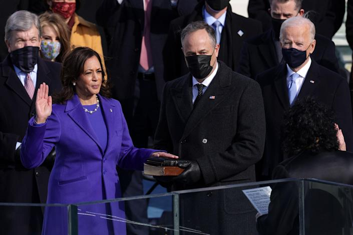 """Kamala Harris is sworn in as Vice President of the United States as her husband Doug Emhoff looks on, in Washington on Jan. 20, 2021.<span class=""""copyright"""">Alex Wong—Getty Images</span>"""