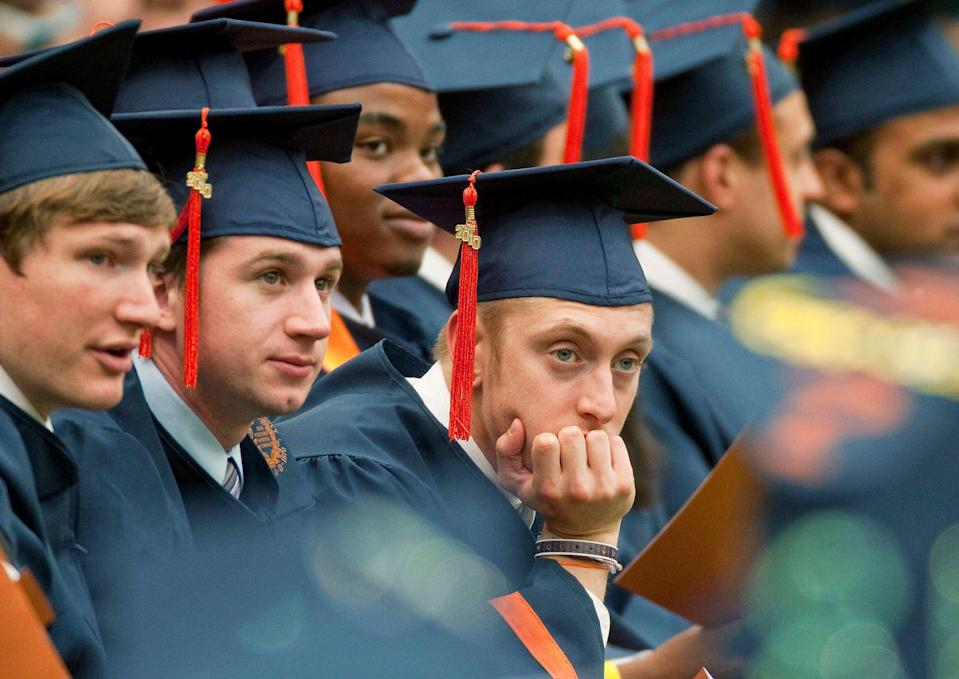 A graduate rests his head in his hand during Syracuse University's commencement ceremony at the Carrier Dome in Syracuse, New York, U.S., on Sunday, May 16, 2010. Students entering one of the weakest job markets in history need to have the courage to speak the truth, 'even when it's unpopular,' JPMorgan Chase & Co. Chief Executive Officer Jamie Dimon told graduates. Photographer: Michael Okoniewski/Bloomberg via Getty Images