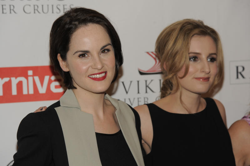 """Michelle Dockery, left, and Laura Carmichael, cast members in the Masterpiece series """"Downton Abbey,"""" pose together at the PBS Summer 2013 TCA press tour at the Beverly Hilton Hotel on Tuesday, Aug. 6, 2013 in Beverly Hills, Calif. (Photo by Chris Pizzello/Invision/AP)"""