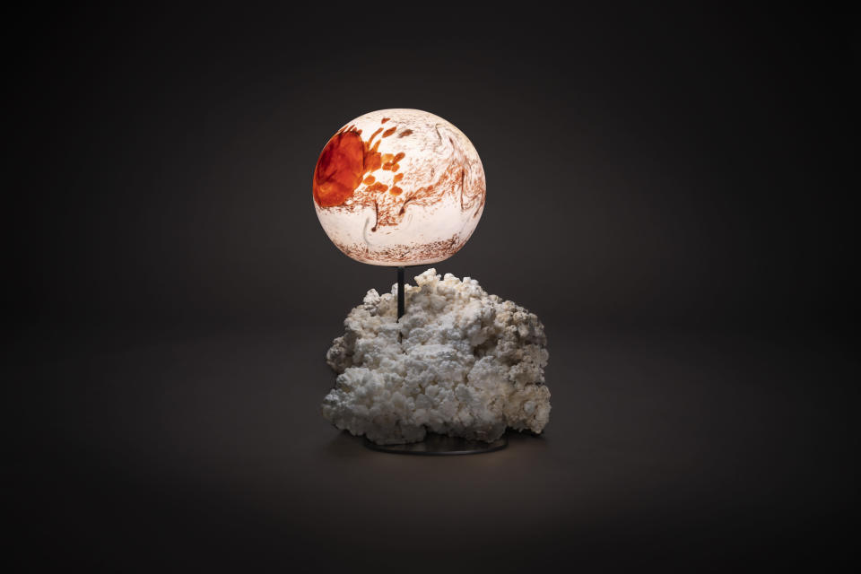 This image provided by Studio Greytak shows an outer space themed lamp. Studio Greytak, in Missoula, Montana, has designed a Jupiter lamp out of the mineral aragonite, depicting the whirling, turbulent gases of the planet. (David Baumstark via AP)