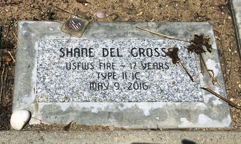 This June 3, 2019 photo shows a memorial stone for Shane Del Grosso at the Wildland Firefighters Monument at the National Interagency Fire Center in Boise, Idaho. Federal officials at the NIFC are bolstering mental health resources for wildland firefighters following an apparent increase in suicides. (AP Photo/Keith Ridler)