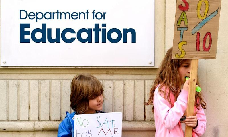 Children hold signs outside the Department of Education during protests at Sats tests for six and seven-year-olds.
