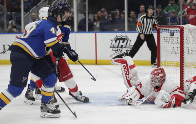 St. Louis Blues' Ivan Barbashev (49) shoots the puck over a prone Detroit Red Wings goaltender Jonathan Bernier (45) for a goal in the second period of an NHL hockey game, Thursday, March 21, 2019, in St. Louis. (AP Photo/Tom Gannam)