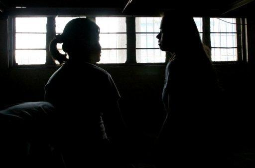 Victims of human trafficking are seen at a halfway house in Manila in 2007
