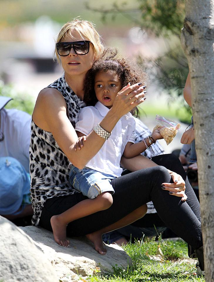 Heidi Klum served as a picnic table for her youngest, Lou, 2, who took a break from playing at a Beverly Hills park to enjoy her snack on her mother's cozy lap. The model, who is adjusting to life as a single mom, recently announced she'll be launching a line of apparel and accessories for Babiesrus.com this fall. (5/7/2012)