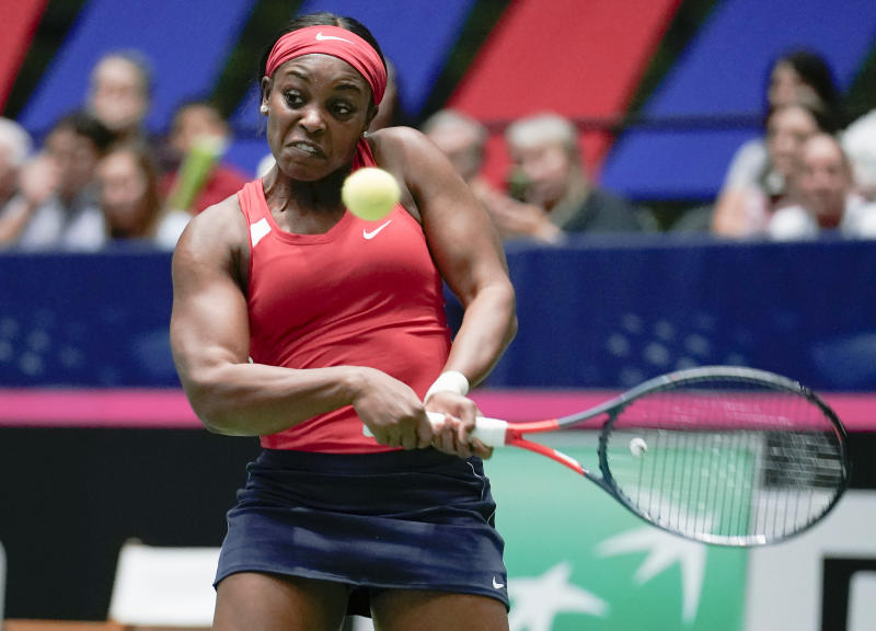 United States' Sloane Stephens returns to Switzerland's Timea Bacsinszky during their playoff-round Fed Cup tennis match, Saturday, April 20, 2019, in San Antonio. (AP Photo/Darren Abate)