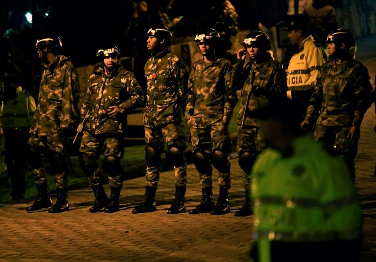 Security forces take position during a protest in front of the house of Colombia's President Ivan Duque, in Bogota, on November 22, 2019