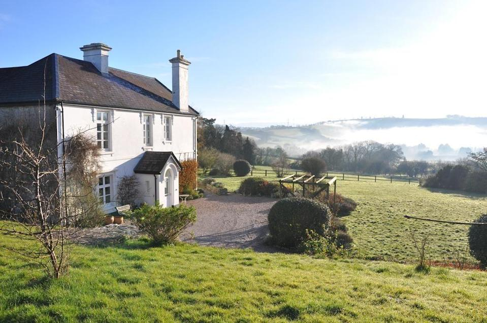 """<p>At the end of the leafy driveway, the quaint <a href=""""https://go.redirectingat.com?id=127X1599956&url=https%3A%2F%2Fwww.booking.com%2Fhotel%2Fgb%2Fbulleigh-barton-manor.en-gb.html%3Faid%3D2070935%26label%3Ddog-friendly-bed-breakfast&sref=https%3A%2F%2Fwww.countryliving.com%2Fuk%2Ftravel-ideas%2Fdog-friendly%2Fg35121802%2Fdog-friendly-bed-and-breakfast-uk%2F"""" rel=""""nofollow noopener"""" target=""""_blank"""" data-ylk=""""slk:Bulleigh Barton Manor"""" class=""""link rapid-noclick-resp"""">Bulleigh Barton Manor</a> looks postcard-perfect within the acres of grounds - which themselves contain a pool, ponds a big colourful garden.<br></p><p>Owners Liz and Mark have restored the house with great attention to detail, uncovering beams and original features, adding personal touches with original art and books. You can explore Dartmoor and the south coast with your pooch, before returning to a friendly welcome by resident dog Zennor.</p><p>Dogs can also enjoy homemade biscuits and dog blankets ,and there are tips for owners on the best walks and dog-friendly pubs.</p><p><a class=""""link rapid-noclick-resp"""" href=""""https://go.redirectingat.com?id=127X1599956&url=https%3A%2F%2Fwww.booking.com%2Fhotel%2Fgb%2Fbulleigh-barton-manor.en-gb.html%3Faid%3D2070935%26label%3Ddog-friendly-bed-breakfast&sref=https%3A%2F%2Fwww.countryliving.com%2Fuk%2Ftravel-ideas%2Fdog-friendly%2Fg35121802%2Fdog-friendly-bed-and-breakfast-uk%2F"""" rel=""""nofollow noopener"""" target=""""_blank"""" data-ylk=""""slk:CHECK AVAILABILITY"""">CHECK AVAILABILITY</a></p>"""