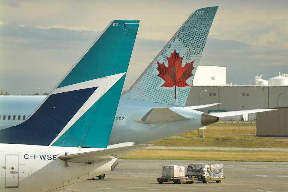 A view of Air Canada and WestJet planes at Calgary International Airport. On Monday, September 10th, 2018, in Calgary, Alberta, Canada. (Photo by Artur Widak/NurPhoto via Getty Images)
