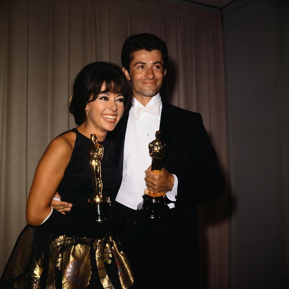 """<p>Rita Moreno wore this shimmery gown in 1962 when she won the award for best supporting actress for her role as Anita in <strong>West Side Story</strong>, then <a href=""""https://www.popsugar.com/fashion/Rita-Moreno-Dress-Oscars-2018-44633087"""" class=""""link rapid-noclick-resp"""" rel=""""nofollow noopener"""" target=""""_blank"""" data-ylk=""""slk:she wore it again at the Oscars in 2018"""">she wore it again at the Oscars in 2018</a>!</p>"""