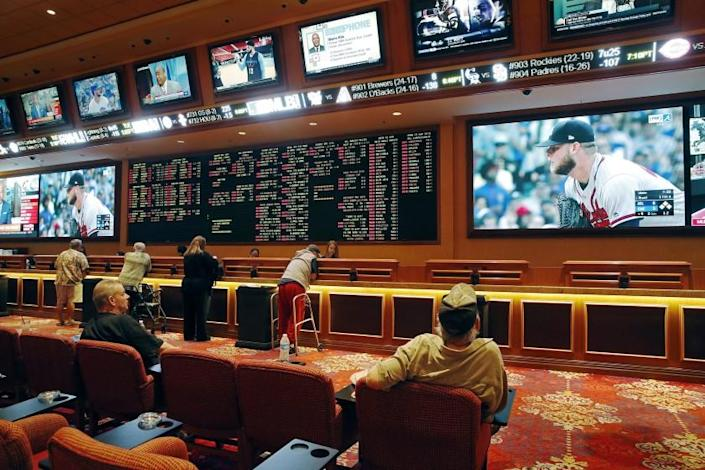 "People make bets in the sports book at the South Point hotel and casino in Las Vegas. Legalized sports gambling in California is at least two years away, but companies are already preparing for a massive response from the public. <span class=""copyright"">(John Locher / Associated Press)</span>"