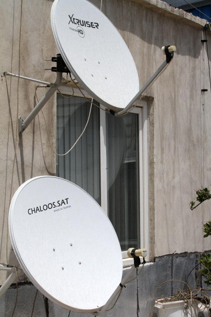 Under Iranian law, satellite equipment is banned and those who distribute, use, or repair them can be fined up to $2,800 (2,500 euros) (AFP Photo/Atta Kenare)