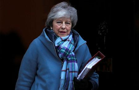 UK PM May will seek 'pragmatic' solution to Brexit deal in Brussels