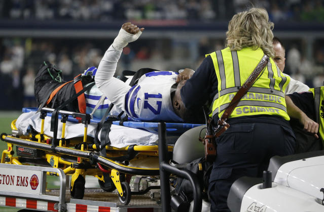Dallas Cowboys wide receiver Allen Hurns (17) is taken from the field after injuring his leg against the Seahawks. (AP)