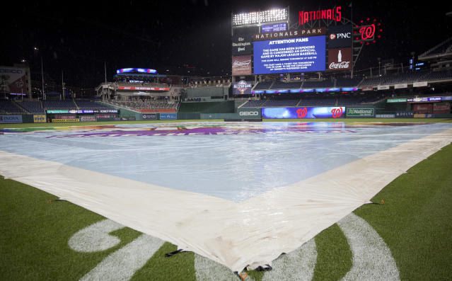 The scoreboard at Nationals Park announces that the interleague baseball game between the New York Yankees and Washington Nationals was suspended due to a severe storm that affected much of the Northeast, Tuesday, May 15, 2018, in Washington. The two teams will resume play tomorrow as part of a double-header. (AP Photo/Pablo Martinez Monsivais)