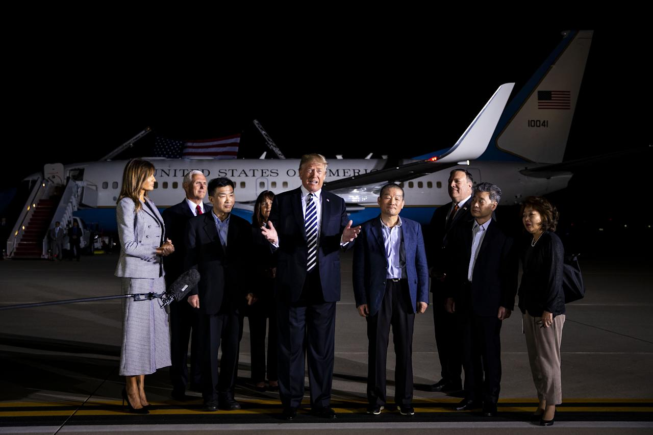 <p>President Donald Trump, center, speaks to members of the media as U.S. First Lady Melania Trump, left, U.S. Vice President Mike Pence, second left, Second Lady Karen Pence, fourth left, and Mike Pompeo, secretary of state, third right, stand with American citizens, released from detention in North Korea, Kim Sang-dok, also known as Tony Kim, third left, Kim Dong-chul, fourth right, and Kim Hak-song, second right, at Joint Base Andrews, Maryland, U.S., on Thursday, May 10, 2018. (Photo: Al Drago/Bloomberg via Getty Images) </p>