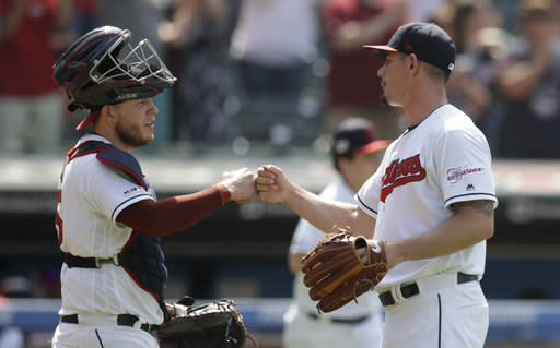 Cleveland Indians relief pitcher Nick Wittgren, right, is congratulated by catcher Roberto Perez after the Indians defeated the Kansas City Royals 5-3 in a baseball game, Wednesday, June 26, 2019, in Cleveland. (AP Photo/Tony Dejak)