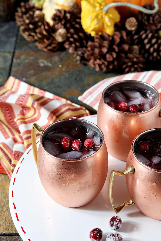 "<p>Now this is what we call Insta-gold. Served in copper mugs, the cranberry mule is sure to keep guests satisfied this festive season. Check out blog <a rel=""nofollow"" href=""https://www.thespeckledpalate.com/cranberry-mule/"">The Speckled Palette</a> for all the info.<br /><br /><strong>Ingredients:</strong><br /><br /><em>Sugared Cranberries (for garnishing)</em><br />12 oz . fresh cranberries<br /> 1/2 cup simple syrup<br /> 1/2 cup granulated sugar<br /><br /><em>Cranberry Mule</em><br />2 oz . unsweetened cranberry juice<br /> 3 oz . ginger beer<br /> 1 1/2 oz . spiced rum<br /> 1 oz . simple syrup<br /> Ice, for serving<br /><br /><em>[Photo: <a rel=""nofollow"" href=""https://www.thespeckledpalate.com/cranberry-mule/"">The Speckled Palette</a>]</em> </p>"