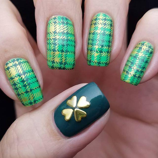"""<p>Something tells us Cher Horowitz from <em>Clueless</em> would have rocked these plaid nails, complete with a heart-turned-clover accent thumb. Boring nails on one of the most fun holidays of the year? Ugh,<em> as if!</em></p><p><a class=""""link rapid-noclick-resp"""" href=""""https://www.amazon.com/Patricks-Irish-Assortment-Water-Decals/dp/B00JAMKVM6/?tag=syn-yahoo-20&ascsubtag=%5Bartid%7C10055.g.26310821%5Bsrc%7Cyahoo-us"""" rel=""""nofollow noopener"""" target=""""_blank"""" data-ylk=""""slk:SHOP SHAMROCK DECALS"""">SHOP SHAMROCK DECALS</a></p><p><a href=""""https://www.instagram.com/p/BgSaS20BxkA/&hidecaption=true"""" rel=""""nofollow noopener"""" target=""""_blank"""" data-ylk=""""slk:See the original post on Instagram"""" class=""""link rapid-noclick-resp"""">See the original post on Instagram</a></p>"""