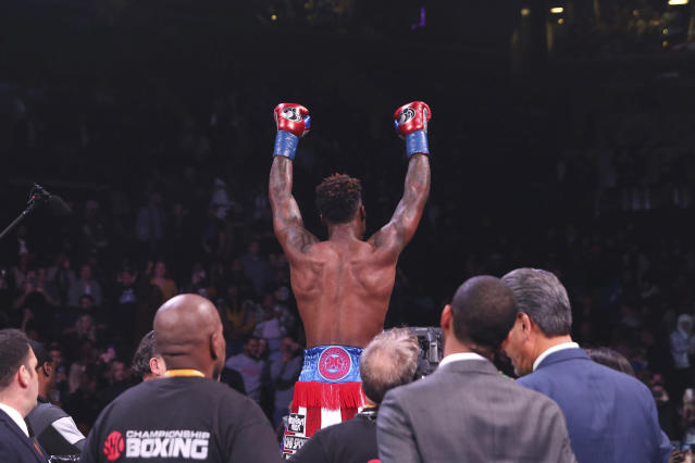 Jermall Charlo celebrates after defeating Ireland's Dennis Hogan during the seventh round of a WBC middleweight title boxing match Saturday, Dec. 7, 2019, in New York. (AP Photo/Michael Owens)