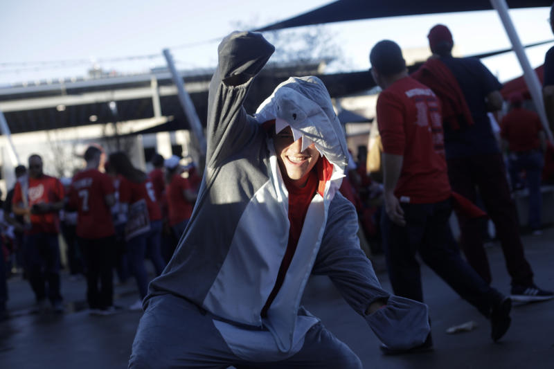 A Washington Nationals fan gestures the baby shark before Game 5 of the baseball World Series against the Houston Astros Sunday, Oct. 27, 2019, in Washington. (AP Photo/Pablo Martinez Monsivais)