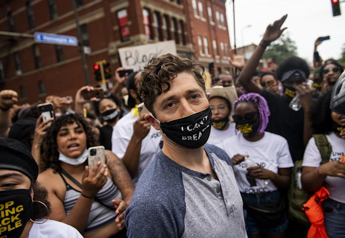 Minneapolis Mayor Jacob Frey leaves after coming to speak during a demonstration calling for the police department to be defunded on June 6. Mayor Frey declined when he was asked if he would fully defund the police and was then asked to leave the protest. (Photo by Stephen Maturen/Getty Images): Getty Images