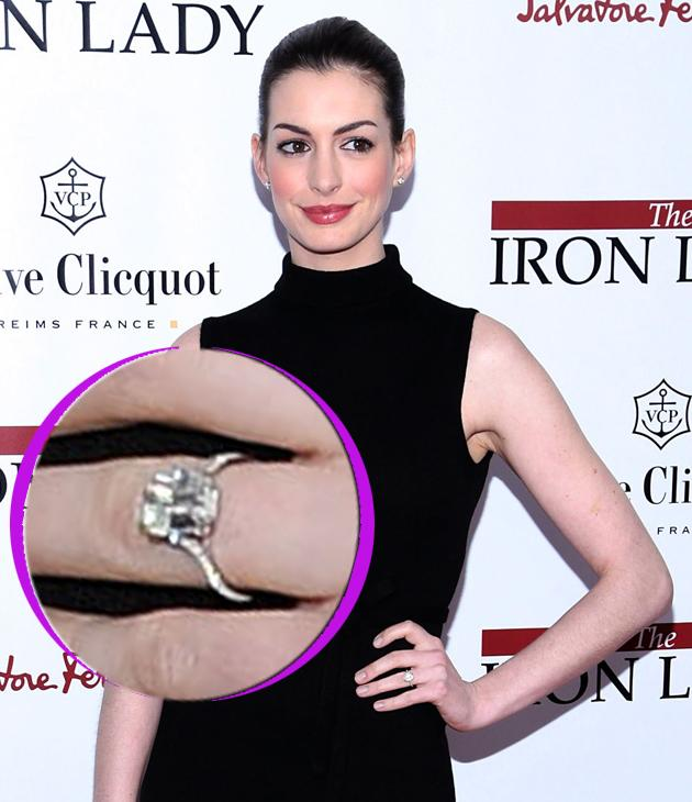 Anne Hathaway engagement ring: Anne left the singles market in true style, with a large square cut sparkler and she looks pretty pleased with her bling. Well, can you blame her?