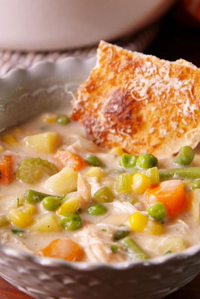 """<p>Cozy up to a bowl of this hearty soup and you might even forget it's Winter.</p><p>Get the recipe from<a rel=""""nofollow"""" href=""""http://www.delish.com/cooking/recipe-ideas/recipes/a51568/chicken-pot-pie-soup-recipe/"""">Delish</a>.</p>"""
