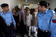 Pakistan's Chief Election Commissioner Fakhruddin Ebrahim, center, arrives along with other members of election commission to announce the name of caretaker prime minister, in Islamabad, Pakistan, Sunday, March 24, 2013. Pakistan's Election commission has chosen a former high court chief justice Mir Hazar Khan Khoso nominated by the country's outgoing ruling party to serve as caretaker prime minister in the run up to a historic national election this spring. (AP Photo/Anjum Naveed)