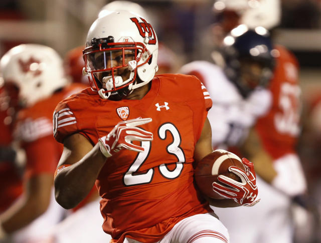 FILE - In this Oct. 8, 2016, file photo ,Utah running back Armand Shyne carries the ball during the second half of an NCAA college football game against Arizona in Salt Lake City. Consecutive season-ending injuries haven't slowed down Shyne in his quest to carve out a major role in Utah's backfield. For the second straight year, Shyne entered spring camp with the Utes trying to bounce back from a major injury. (AP Photo/George Frey, File)