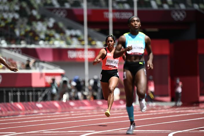 Singapore's Veronica Shanti Pereira (left) competes in the women's 200m heats during the 2020 Tokyo Olympics. (PHOTO: Jewel Samad/AFP)