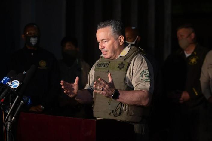 """Sheriff Alex Villanueva speaks at a news conference outside the emergency room of St. Francis Medical Center, where two L.A. County sheriff's deputies were being treated after being shot Saturday. <span class=""""copyright"""">(Jason Armond / Los Angeles Times)</span>"""