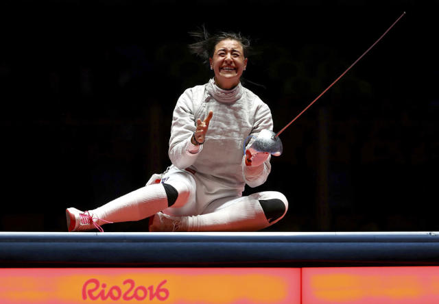 <p>Yana Egorian of Russia celebrates winning gold in the women's sabre individual fencing final on August 8, 2016. (REUTERS/Lucy Nicholson) </p>