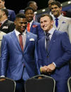 Buffalo Khalil Mack, left, greets Texas A&M quarterback Johnny Manziel as they are introduced during the first round of the 2014 NFL Draft, Thursday, May 8, 2014, in New York. (AP Photo/Frank Franklin II)