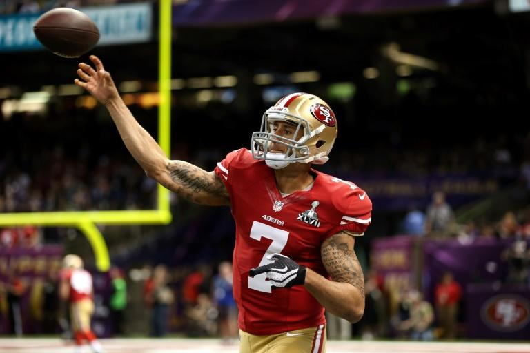 Colin Kaepernick remains unemployed despite his eagerness to return to the NFL (AFP Photo/Chris Graythen)