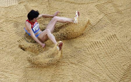 FILE PHOTO: Russia's Victoria Valyukevich competes in the women's triple jump final during the London 2012 Olympic Games at the Olympic Stadium August 5, 2012. REUTERS/Reinhard Krause