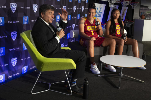 Southern California head coach Mark Trakh, from left, along with players Kayla Overbeck and Stephanie Watts, speaks to reporters during the Pac-12 Conference women's NCAA college basketball media day, Monday, Oct. 7, 2019, in San Francisco. (AP Photo/D. Ross Cameron)