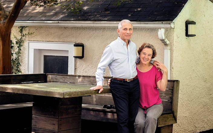 With his wife, Christine Grady, at home in Washington, DC in June last year - Redux / eyevine