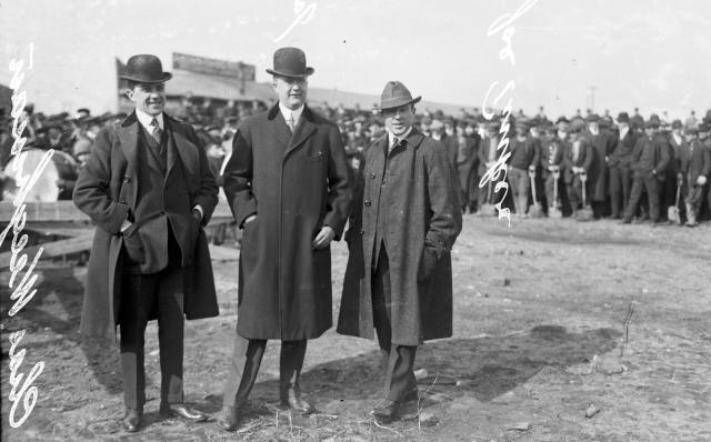 This 1914 photo provided by the Chicago History Museum shows, from left to right, Charles Weeghman, James Gilmore, and Federal League baseball player Joe Tinker (wearing street clothes), attending the groundbreaking of Weeghman Park in Chicago. Weeghman Park was renamed Wrigley Field in 1927. The famed ballpark will celebrate it's 100th anniversary on April 23, 2014. (AP Photo/Courtesy of the Chicago History Museum)