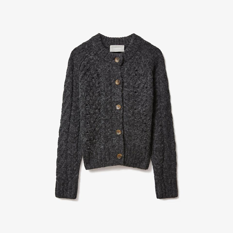"""<p><strong>Everlane</strong></p><p>everlane.com</p><p><a href=""""https://go.redirectingat.com?id=74968X1596630&url=https%3A%2F%2Fwww.everlane.com%2Fproducts%2Fwomens-cloud-cable-cardigan-charcoal&sref=https%3A%2F%2Fwww.seventeen.com%2Ffashion%2Fg37090791%2Feverlane-summer-sale-best-items%2F"""" rel=""""nofollow noopener"""" target=""""_blank"""" data-ylk=""""slk:Shop Now"""" class=""""link rapid-noclick-resp"""">Shop Now</a></p><p><strong><del>$148</del> $103</strong></p><p>If you're returning to class this fall, you're in need of a new commuter sweater. This cozy cardigan could almost double as a jacket. </p>"""