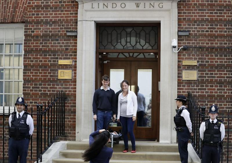 This unsuspecting couple were caught up in the Kate Middleton labour frenzy at the Lindo Wing. Photo: AAP