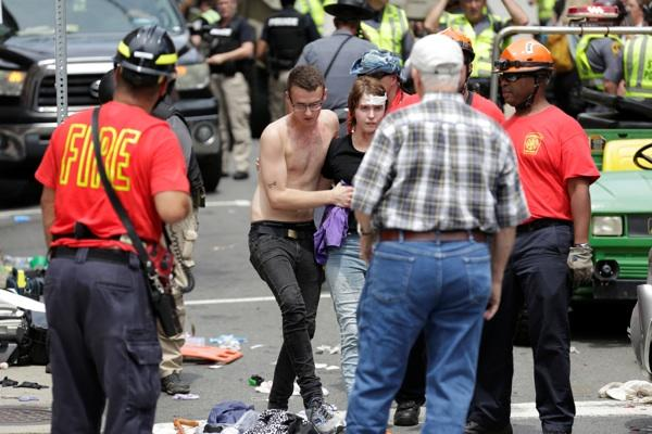 Driver crashes his car in a crowd of protesters in Charlottesville