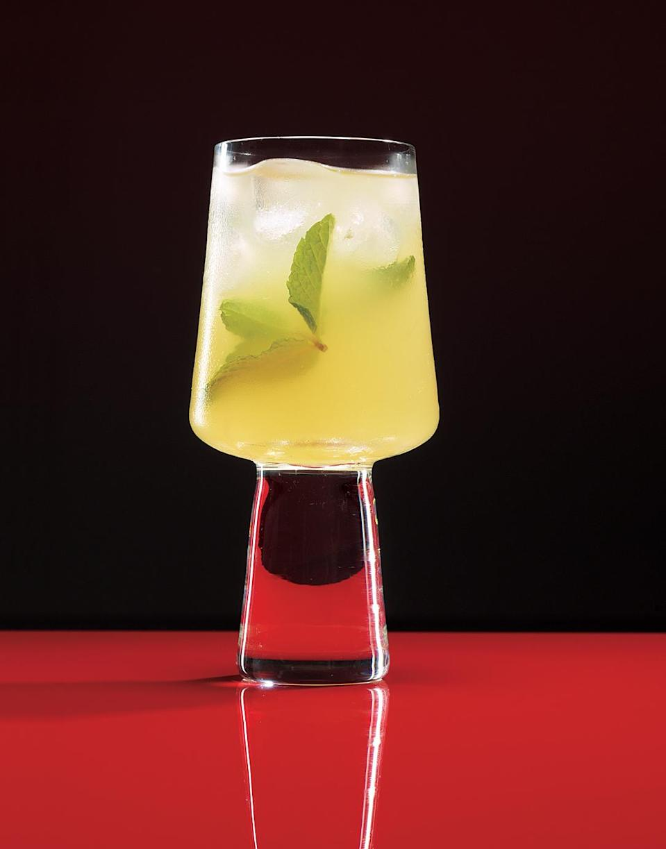 """<p>If you're making tropical cocktails for a small crowd, a punch is the simplest way. This fizzy option calls for gin, for tropical-drink lovers who aren't in love with rum. </p> <p><strong>Related: <a href=""""https://www.realsimple.com/food-recipes/recipe-collections-favorites/best-cocktail-recipes"""" rel=""""nofollow noopener"""" target=""""_blank"""" data-ylk=""""slk:22 Cocktail and Punch Recipes for Easy Entertaining"""" class=""""link rapid-noclick-resp"""">22 Cocktail and Punch Recipes for Easy Entertaining</a></strong></p>"""