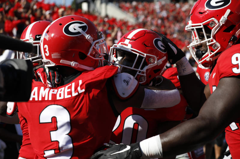 Georgia defensive back J.R. Reed (20) celebrates with teammates after scoring a touchdown in the first half of an NCAA college football game against Murray State, Saturday, Sept. 7, 2019, in Athens, Ga. (Joshua L. Jones/Athens Banner-Herald via AP)