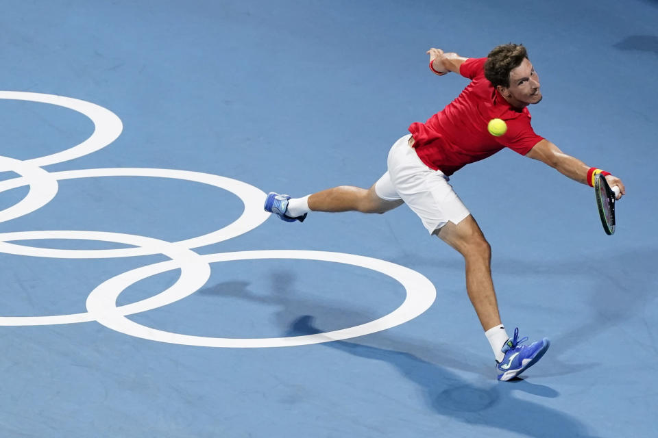 Pablo Carreno Busta, of Spain, returns to Daniil Medvedev, of the Russian Olympic Committee, during the quarterfinal round of the men's tennis competition at the 2020 Summer Olympics, Thursday, July 29, 2021, in Tokyo, Japan. (AP Photo/Patrick Semansky)