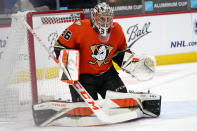 Anaheim Ducks goaltender John Gibson looks to stop a shot by the Colorado Avalanche in the first period of an NHL hockey game Friday, March 5, 2021, in Denver. (AP Photo/David Zalubowski)